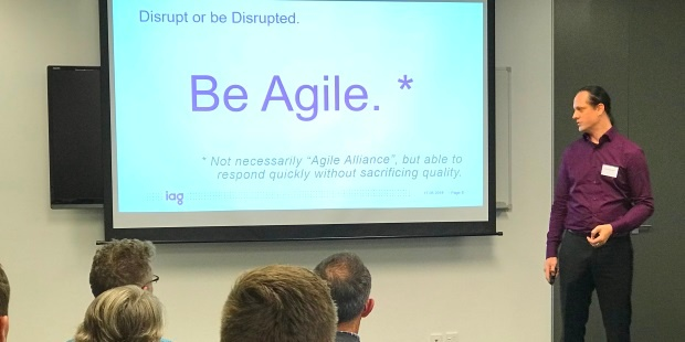 Daniel Scott-Raynsford, Continuous Delivery Practice Lead at IAG New Zealand, showing why they needed to 'be Agile'
