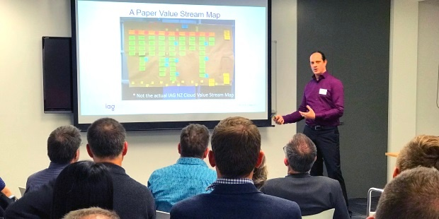 Daniel Scott-Raynsford, Continuous Delivery Practice Lead at IAG New Zealand, discussing value stream mapping