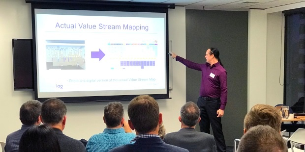 Daniel Scott-Raynsford, Continuous Delivery Practice Lead at IAG New Zealand, presents on their journey to the cloud at an Equinox IT hosted event