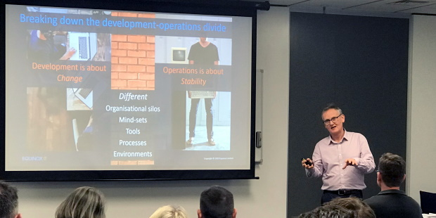 Equinox IT Principal Consultant Bill Ross presenting on breaking down the development-operations divide