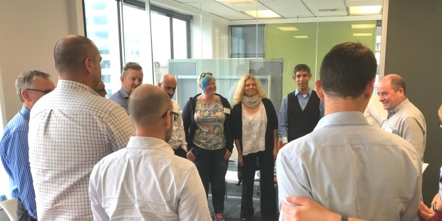 Michael Sahota and Audree Tara lead the 'check out' stand-up circle at the end of the Agile leadership and culture overview with Equinox IT