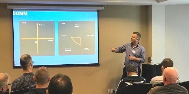 Equinox IT Principal Consultant Julien Thomas presenting on DevOps maturity