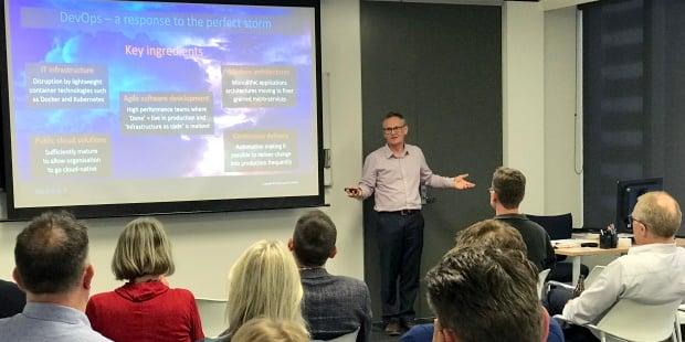 Equinox IT Principal Consultant Bill Ross presenting on DASA DevOps frameworks at an Equinox IT client event